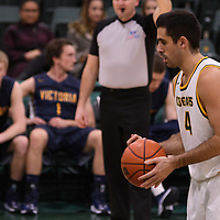 4th year guard Alex Igual (4) of the Regina Cougars in action during the home opener  on November  4 at Centre for Kinesiology, Health and Sport. Credit: /Arthur Images