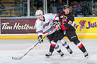 KELOWNA, CANADA - MARCH 9: Jared Bethune #21 of Prince George Cougars checks Kole Lind #16 of Kelowna Rockets on March 9, 2016 at Prospera Place in Kelowna, British Columbia, Canada.  (Photo by Marissa Baecker/Shoot the Breeze)  *** Local Caption *** Jared Bethune; Kole Lind;