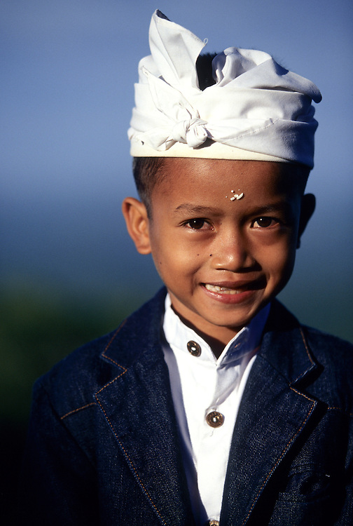 Asia, Indonesia, Bali, Besakih, boy (age 6)  in traditional clothing at festival