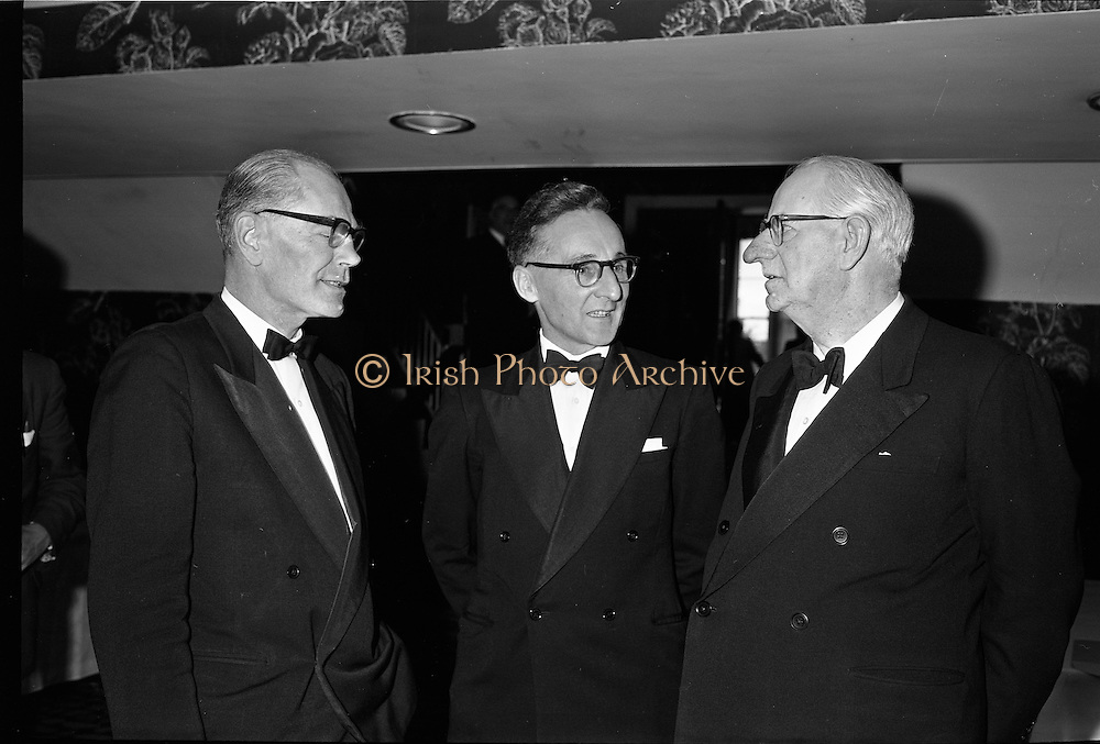 20/08/1962<br /> 08/20/1962<br /> 20 August 1962 <br /> Efficient Distribution Ltd. Dinner at Shelbourne Hotel, Dublin. Chatting during the reception were (l-r): A.H. Harris; Dave Tyndall and R. Thompson.