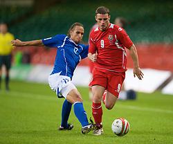 CARDIFF, WALES - Friday, September 5, 2008: Wales' Jason Koumas and Azerbaijan's Fabio Luis Ramim during the opening 2010 FIFA World Cup South Africa Qualifying Group 4 match at the Millennium Stadium. (Photo by David Rawcliffe/Propaganda)