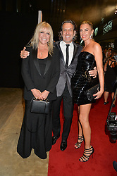 Left to right, JO WOOD, STEPHEN WEBSTER and ASSIA WEBSTER at the GQ Men of The Year Awards 2016 in association with Hugo Boss held at Tate Modern, London on 6th September 2016.