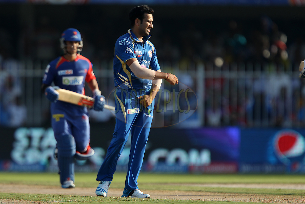 Rohit Sharma captain of of the Mumbai Indians reacts after a delivery during match 16 of the Pepsi Indian Premier League 2014 between the Delhi Daredevils and the Mumbai Indians held at the Sharjah Cricket Stadium, Sharjah, United Arab Emirates on the 27th April 2014<br /> <br /> Photo by Ron Gaunt / IPL / SPORTZPICS