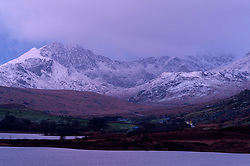 © Licensed to London News Pictures. 22/01/2019. Snowdonia, Gwynedd, Wales, UK. Dawn breaks on a cold day in Snowdonia National Park, Gwynedd, UK. credit: Graham M. Lawrence/LNP