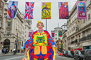 Royal Academician Grayson Perry with his street flags in Piccadilly, London's West End. It was part of the celebrations of the RA 250, their 250th Anniversary.
