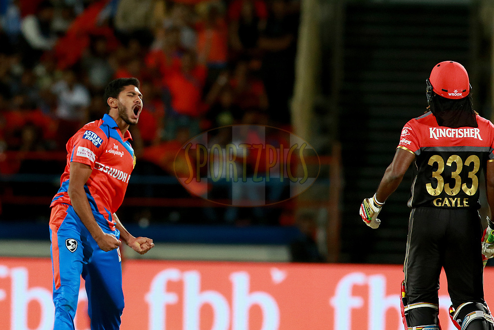 Basil Thampi of GL celebrates after takes wicket of Chris Gayle of RCB during match 20 of the Vivo 2017 Indian Premier League between the Gujarat Lions and the Royal Challengers Bangalore  held at the Saurashtra Cricket Association Stadium in Rajkot, India on the 18th April 2017<br /> <br /> Photo by Rahul Gulati - Sportzpics - IPL