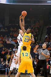 Virginia Cavaliers F/C Ryan Pettinella (34) battles Vermont Catamounts F Marqus Blakely for the opening tip off.  The Virginia Cavaliers men's basketball team defeated the Vermont Catamounts 90-72 at the John Paul Jones Arena in Charlottesville, VA on November 11, 2007.