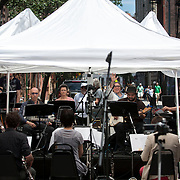 """June 21, 2014 - New York, NY : <br /> The city was flooded with music on Saturday as Make Music New York brought more than 1,300 free concerts to the city's streets and parks. The annual festival's program included the performance """"'In (Key)' - New Compositions in Celebration of Terry Riley's 'In C' @ 50 Years"""" on Cornelia Street, in front of the Cornelia Street Cafe in Greenwich Village, on Saturday afternoon. The musicians played in the middle of Cornelia Street under white tents. <br /> CREDIT: Karsten Moran for The New York Times"""