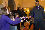 Matt Thompson is greeted by children handing out candy canes during the Military Bowl welcome reception on Dec. 24th for East Carolina University football team  at the Mayflower Hotel in Washington, DC, where they will be staying for the Military Bowl. They will face the University of Maryland in the Military Bowl on December 29, 2010. (Photo by Alan Lessig)