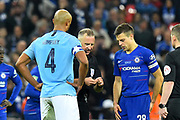 Referee Jon Moss does the coin toss before extra time during the Carabao Cup Final match between Chelsea and Manchester City at Wembley Stadium, London, England on 24 February 2019.