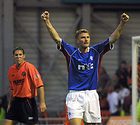 Fotball: Dundee Utd v Rangers 22.09.01. Tore Andre Flo scores his salutes the fans after scoring his third goal of the match as David Partridge lets his feelings show .<br />