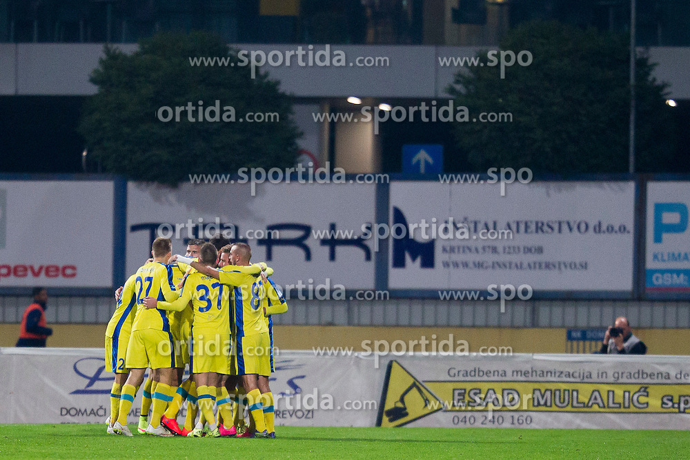 Players of NK Domzale celebrate during football match between NK Domzale and NK Krka in 14th Round of Prva liga Telekom Slovenije 2015/16, on October 17, 2015 in Sports park Domzale, Slovenia. Photo by Urban Urbanc / Sportida