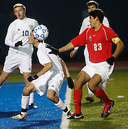 Quincy Devlin, left, of Lake George heads the ball away from Jonathan Nierenberg (23)  of Friends Academy during a Class C state semifinal game at Faller Field in Middletown on Saturday, Nov. 16, 2013. (Tom Bushey – Special to The Post-Star)