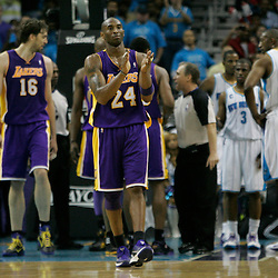 April 28, 2011; New Orleans, LA, USA; Los Angeles Lakers shooting guard Kobe Bryant (24) applauds after being fouled during the third quarter in game six of the first round of the 2011 NBA playoffs against the New Orleans Hornets at the New Orleans Arena.    Mandatory Credit: Derick E. Hingle