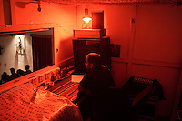 SLIEMA, MALTA - 8 FEBRUARY 2016: A technician of the Salesian Theatre controls the lights as the touring Hamlet is performed by the Shakespeare's Globe theatre company, in Sliema, Malta, on February 8th 2016.<br /> <br /> The touring Hamlet, performed by the Shakespeare's Globe theatre company, is part of the Globe to Globe tour that set off in April 2014 (on the 450th anniversary of Shakespeare's birth) with the ambitious intention of visiting every country in the world over 2 years. The crew is composed of a total of sixteen men and women: four stage managers and twelve twelve actors  actors perform over two dozen parts on a stripped-down wooden stage. So far Hamlet has been performed in over 150 countries, to more than 100,000 people and travelled over 150,000 miles. The tour was granted UNESCO patronage for its engagement with local communities and its promotion of cultural education. Hamlet was also played for many dsiplaced people around the world. It was performed in the Zaatari camp on the border between Syria and Jordan, for Central African Republic refugees in Cameroon, and for Yemeni people in Djibouti. On February 3rd it was performed to about 300 refugees in Calais at the camp known as the Jungle.