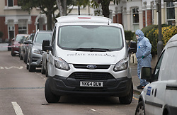 © Licensed to London News Pictures. 21/09/2017. London, UK. A  Private Ambulance removes a body from a house where police and the fire brigade attended and found a burnt body in the garden in Southfields, south London A 40-year-old man and a 34-year-old woman were arrested at the scene on Wednesday, 20 September on suspicion of murder. Photo credit: Peter Macdiarmid/LNP