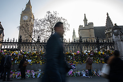 © Licensed to London News Pictures . 28/03/2017 . London , UK . Flowers and tributes on the railings outside the Palace of Westminster , in response to Khalid Masood's terrorist attack and the killing of PC Keith Palmer . Photo credit: Joel Goodman/LNP