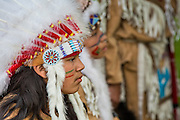 23 APRIL 2012 - PHOENIX, AZ:   A young member of an Apache Indian dance troupe waits to perform a blessing dance at the Arizona State Capitol Monday. About 200 high school students from across the Phoenix metropolitan area rallied at the Arizona state capitol in Phoenix Monday to show their opposition to Arizona's tough anti-immigration law, SB 1070. April 23 is the 2nd anniversary of the law's signing. The US Supreme Court is taking up the law during a hearing Wednesday, April 25 in Washington DC.        PHOTO BY JACK KURTZ