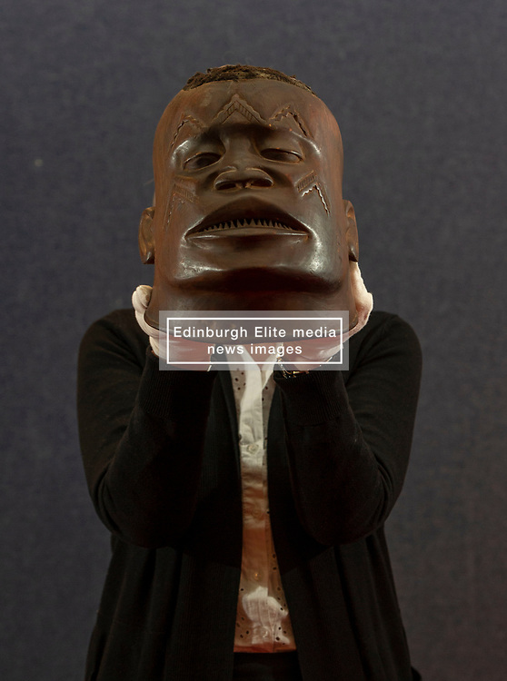 Pictured: Lyon and Turnbull's Deborah Hood with a Makonde Helmet Mask from Lipiko,  Mozanbique<br /> <br /> A coconut collecting box valued at GBP500-GBP700, once in the possession of Scottish missionary John Paton, is among the highlights of the African & Oceanic Sale which takes place on 1 May.<br /> <br /> Ger Harley | EEm 29 April 2019