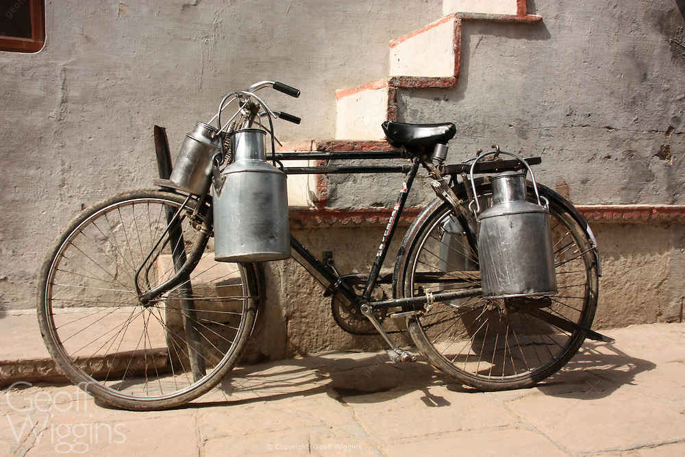 Old bicycle with milk churns. Varanasi India