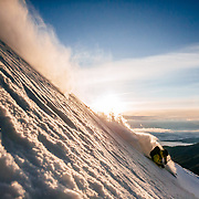 Forrest Jillson skis sunrise powder in Wyoming.