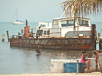 Little local girl plays near docks in Placencia, Belize.  Copyright 2014 Reid McNally.