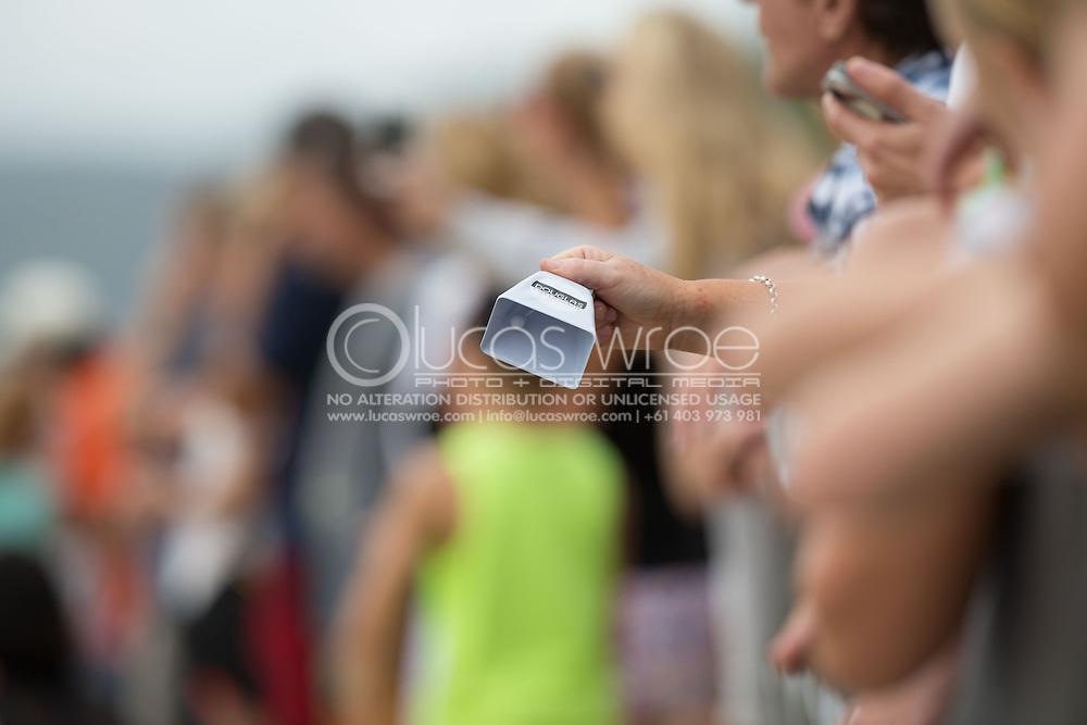 Spectators cheer on competitors with Douglas cow bells, June 1, 2014 - TRIATHLON : Coral Coast 5150 Triathlon, Cairns Airport Adventure Festival, Four Mile Beach, Port Douglas, Queensland, Australia. Credit: Lucas Wroe