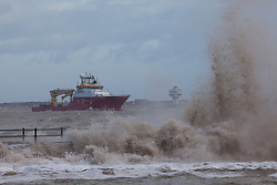 © Licensed to London News Pictures. 03/01/2014.New Brighton, UK . A ship enters the River Mersey as the high tide arrives. Photo credit : Andrew Dawson/LNP