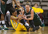 January 27 2010: Iowa guard Kachine Alexander (21) and Michigan St. forward Taylor Alton (33) battle for a lose ball during the second half of an NCAA women's college basketball game at Carver-Hawkeye Arena in Iowa City, Iowa on January 27, 2010. Iowa defeated Michigan State 66-64.