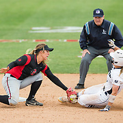 12 May 2018: San Diego State second baseman Katie Byrd (11) tags out a Utah State player attempting to steal second base. San Diego State women's softball closed out the season against Utah State with a 4-3 win on seniors day and sweep the series. <br /> More game action at sdsuaztecphotos.com