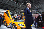 New York, NY - 1 April 2015. British carmaker McLaren's CEO Mike Flewitt talks to reporters about its entry-level 570S mid-engine sportscar at the New York International Auto Show. The car is priced at £145,000, about US$180,000.