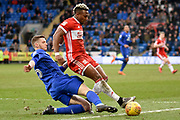 Cardiff City defender Greg Halford (15) tackles Middlesbrough forward Adama Traore (37) 1-0 during the EFL Sky Bet Championship match between Cardiff City and Middlesbrough at the Cardiff City Stadium, Cardiff, Wales on 17 February 2018. Picture by Alan Franklin.