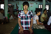 Daw Moe Moe Thet, 49, waits to see a doctor at a clinic in East Dagon township.