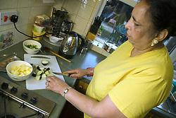 Older woman preparing vegetables,