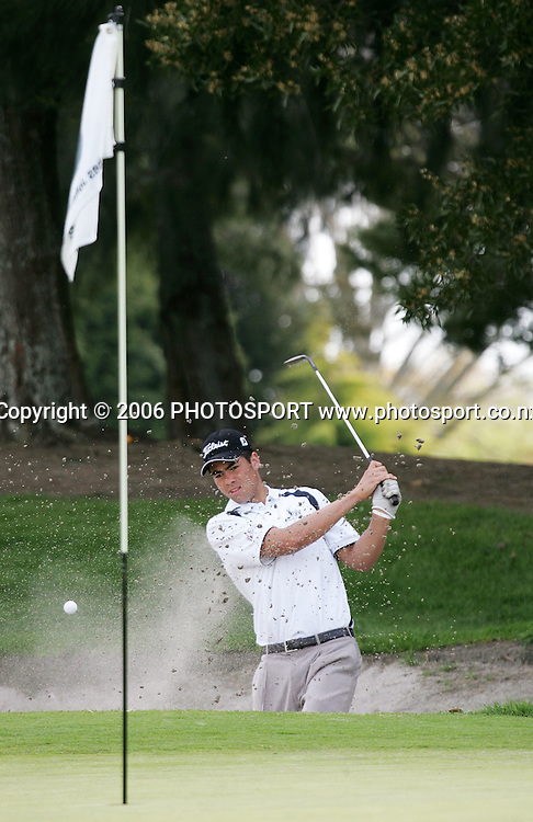 New Zealand's Gary John Hill plays out of a bunker during the Clare Higson Trophy singles match between New Zealand's Gary John Hill and Australia's Matt Jager at Hamilton Golf Club in Hamilton, New Zealand on Wednesday 27 September, 2006. Photo: Tim Hales/PHOTOSPORT