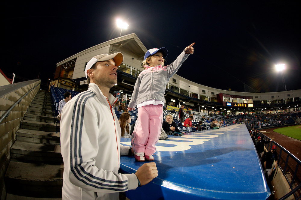 (20110609, Davenport, Iowa)..Josh Lichty, left, of Bettendorf, IA looks on with his daughter Zoey, 2, as the Quad Cities River Bandits faced the Lansing Lugnuts at Modern Woodmen Park in Davenport, Iowa on Thursday, June 9, 2011.  The River Bandits lost, 0-2...Brooks Canaday.