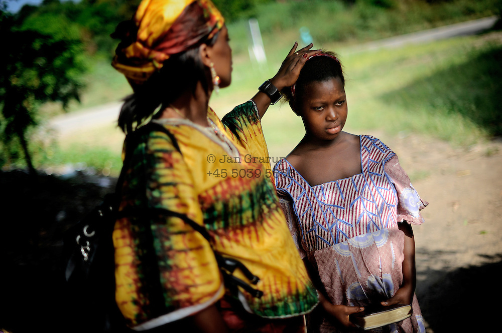 Rugiatu Turay strokes the hair of Isattu Jalloh, 11. The girl is 7 months pregnant and was taken in by Turay who founded a grassroot organization Amazonian Initiative Movement in Lunsar, Sierra Leone. She fights against female genital mutilation and maternal health in the district. The girl was circumcised at the age of 6 and then raped by her uncle. As girls are seen as sexually mature after circumcision, the rate of child marriages is quite high. Often, the bodies of the girls are not yet ready for giving birth. Isattu will deliver via C-section in a local hospital.