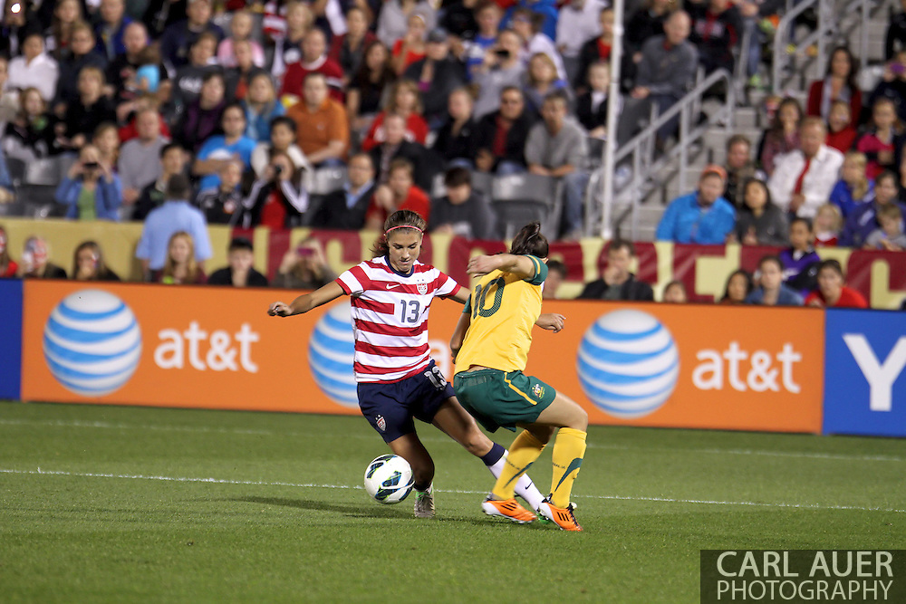 September 19, 2012 Commerce City, CO.  USA f Alex Morgan (13) attempts to get past Australia d Yesim Servet Uzunlar (10) during the Soccer Match between the USA Women's National Team and the Women's Australian team at Dick's Sporting Goods Park in Commerce City, Colorado