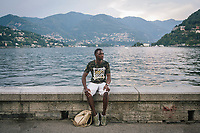 COMO, ITALY - 21 JUNE 2017: Fofana Abdoulaye, a 31-years old migrant fro the Ivory Coast whose fream was to become a politician, poses for a portrait here by Lake Como in Como, Italy, on June 21st 2017.<br /> <br /> Residents of Como are worried that funds redirected to migrants deprived the town's handicapped of services and complained that any protest prompted accusations of racism.<br /> <br /> Throughout Italy, run-off mayoral elections on Sunday will be considered bellwethers for upcoming national elections and immigration has again emerged as a burning issue.<br /> <br /> Italy has registered more than 70,000 migrants this year, 27 percent more than it did by this time in 2016, when a record 181,000 migrants arrived. Waves of migrants continue to make the perilous, and often fatal, crossing to southern Italy from Africa, South Asia and the Middle East, seeing Italy as the gateway to Europe.<br /> <br /> While migrants spoke of their appreciation of Italy's humanitarian efforts to save them from the Mediterranean Sea, they also expressed exhaustion with the country's intricate web of permits and papers and European rules that required them to stay in the country that first documented them.