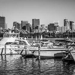 Boston Skyline black and white picture with boats along the Charles River. Boston Massachusetts is a major city in the Eastern United States of America.