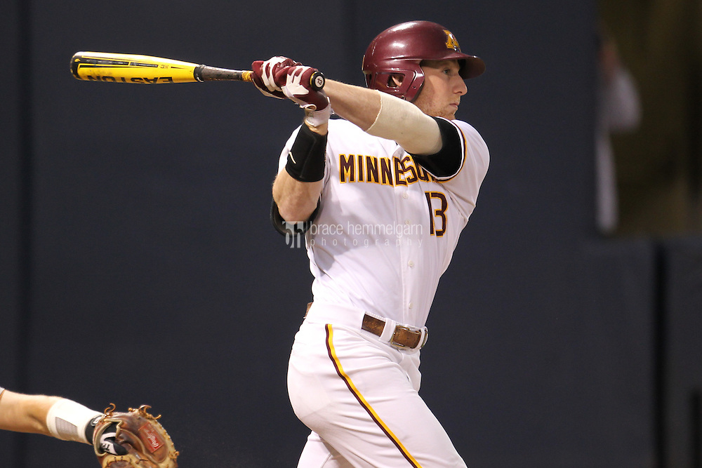 Minnesota Golden Gophers outfielder Andy Henkemeyer #13 bats during a game against the Texas Longhorns at the Metrodome on March 22, 2013 in Minneapolis, Minnesota. (Brace Hemmelgarn)