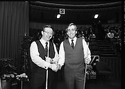 The Benson and Hedges .Irish Masters Snooker..1984..28.03.1984..03.28.1984..28th March 1984..The championship was held at Goffs,Co Kildare. All the top names in snooker took part..Steve Davis,Jimmy White,Eddie Charlton,.Tony Knowles,Dennis Taylor,Tony Meo,.Alex Higgins,Ray Reardon,.Cliff Thorburn,Terry Griffiths,.Bill Werbeniuk and Eugene Hughes..The eventual winner was Steve Davis who beat Terry Griffiths 9 -1 in the final..Image taken as Dennis Taylor  and Terry Griffiths pose for the cameras..