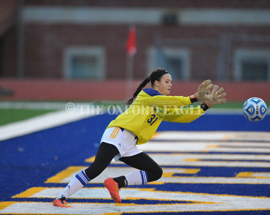 Oxford High goalkeeper Bailey O'Connor knocks down a shot against Pearl in girls high school soccer in Oxford, Miss. on Wednesday, November 26, 2014. Oxford won 3-0.