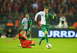 BRUSSELS, BELGIUM - Tuesday, October 15, 2013: Wales' captain Aaron Ramsey in action against Belgium's Axel Witsel during the 2014 FIFA World Cup Brazil Qualifying Group A match at the Koning Boudewijnstadion. (Pic by David Rawcliffe/Propaganda)