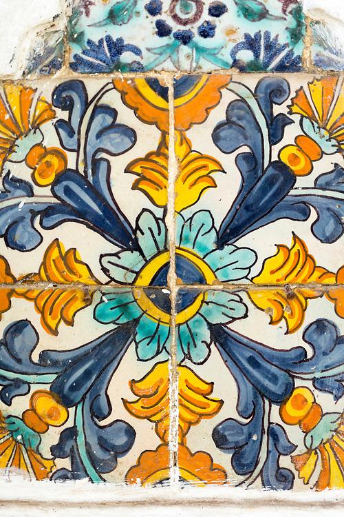 TETOUAN, MOROCCO - 6th April 2016 - Moroccan doorway zelij mosaic floral pattern tiling, Tetouan Medina, Rif region of Northern Morocco.