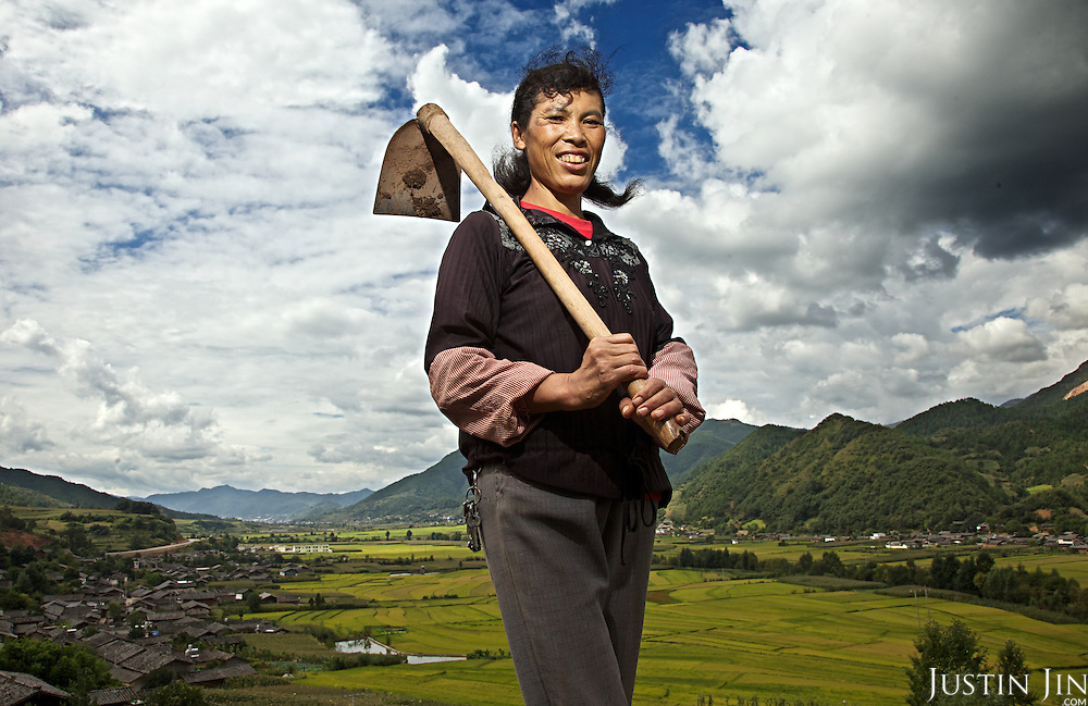 Hua (surname) Dexiang, 42, a woman belonging to the Naxi minority near her village in Yunnan province.