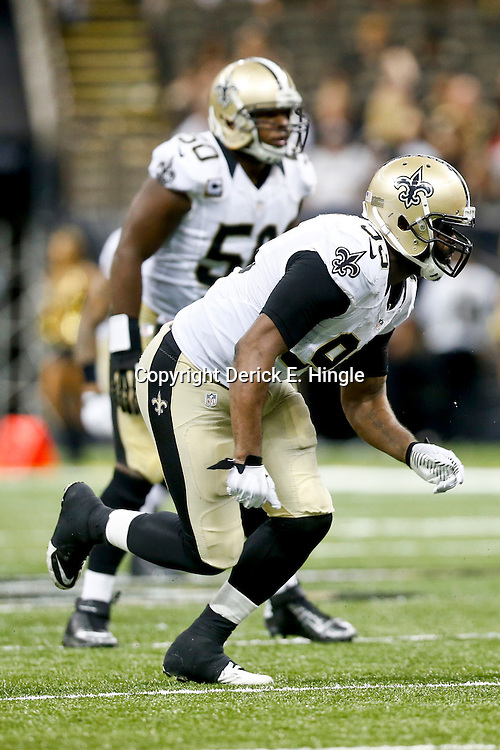 Sep 22, 2013; New Orleans, LA, USA; New Orleans Saints outside linebacker Junior Galette (93) against the Arizona Cardinals during a game at Mercedes-Benz Superdome. The Saints defeated the Cardinals 31-7. Mandatory Credit: Derick E. Hingle-USA TODAY Sports