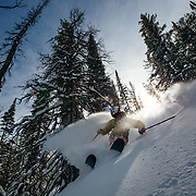 Tanner Flanagan skis blue bird powder in the backcountry near Jackson Hole Mountain Resort, Wyoming.