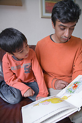 Father reading a book to his son,