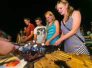 Students roast marshmallows own the Terrace at Sunburst Festival at Memorial Union in 2014.